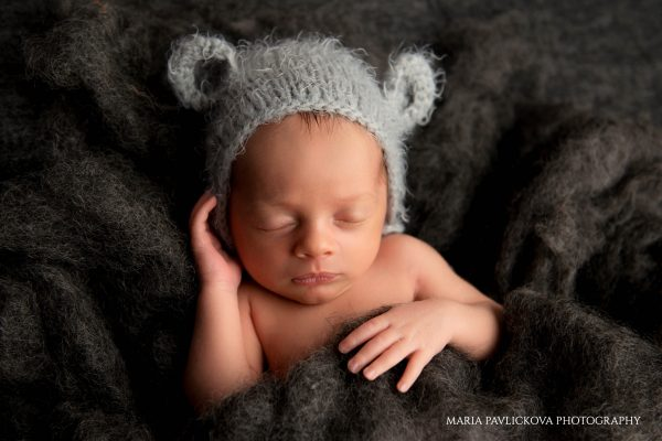 newborn with teddy bear hat